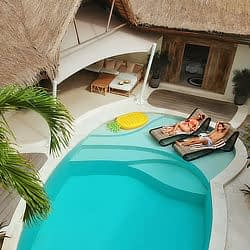 Couple relaxes by pool at their villa