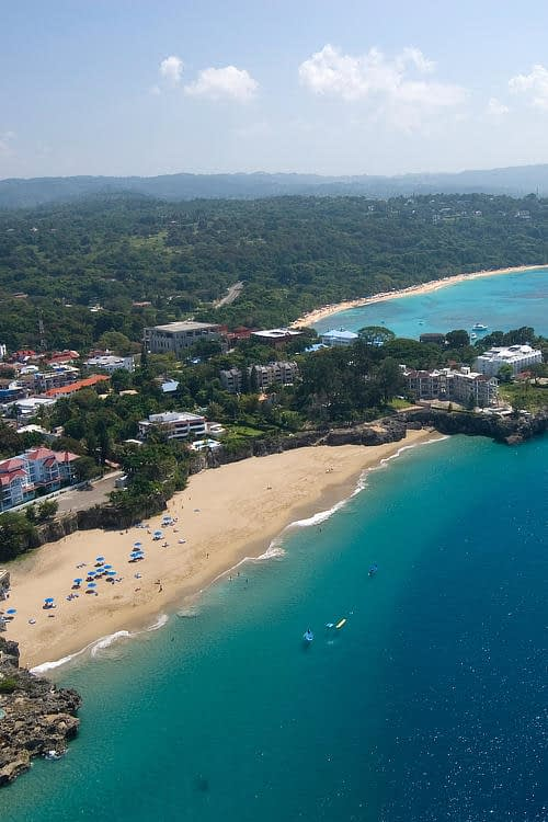 Sosua Beach and surrounding town from the air on sunny day